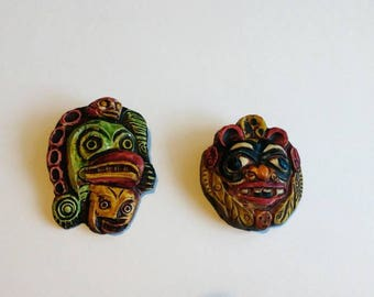 Two vintage Aztec inspired brooches