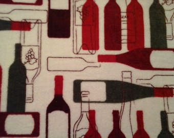 Double kitchen towel wih red, Burgandy,  gray wine bottles. Crocheted red top.
