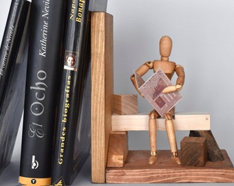 Wooden bookends with articulated puppet.