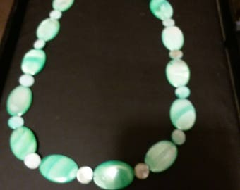 Green mother of pearl necklace.