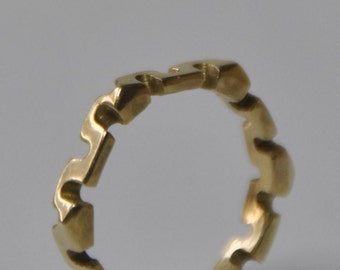 Worked brass ring