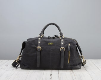 Personalised waxed canvas and leather holdall bag in black