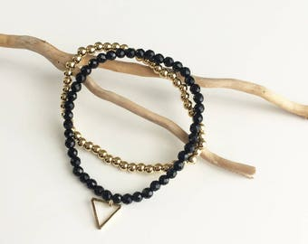 "gold plated ""dune"" beads and onyx bracelet duo"