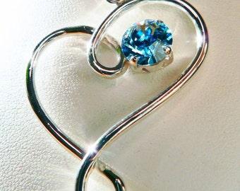 Angel's Heart. Sterling silver pendant and blue Swarovski.