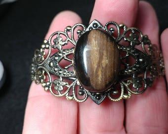 Brass tone cuff bracelet with petrified wood stone. Petrified wood cuff bracelet. Cuff bracelet stone and brass