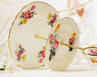2 tier cake stand: English bone china 2 tier cakestand / dessert stand /cupcake stand. Perfect for taking afternoon tea.
