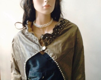 This cape is made of bronze colored silk taffeta and lined with gold china silk