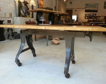 Vintage industrial cast iron machine base dining table