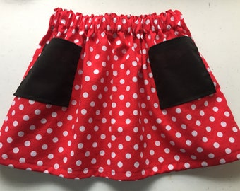 Little Girl's Red and White Polka Dot Skirt with Black Pockets