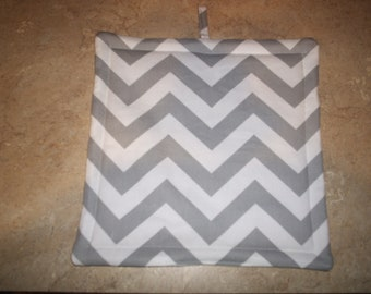 Set of 2 Potholders in Gray and White Chevron fabric.