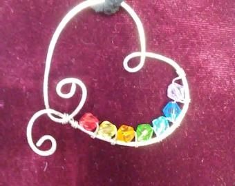 silver chakra floating heart pendant