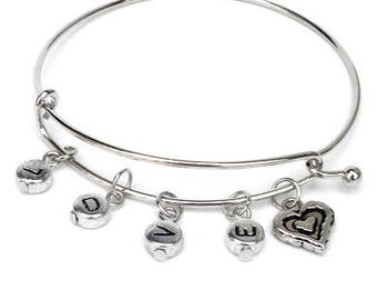Silver-colored metal bracelet with letter charms. Personalized bracelet with text, bangle wristband, letter beads, wristlet, custom jewelry