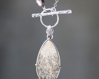 Large Dendritic quartz pendant necklace set in silver bezel and brass prongs setting with blue topaz on the side on oxidized silver chain