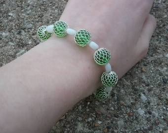 Unique green and white beaded bracelet