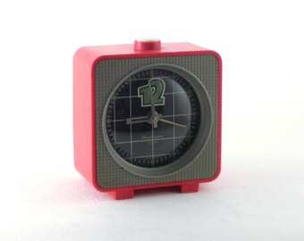 Vintage red alarm clock  made in Russia