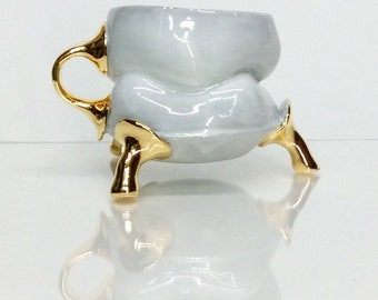 white and gold mug with small one finger handle