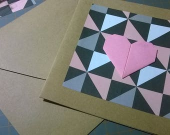 Origami card, pink heart on geometric background