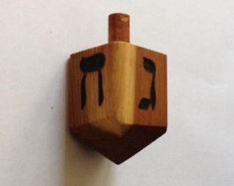 Handcrafted redwood dreidels