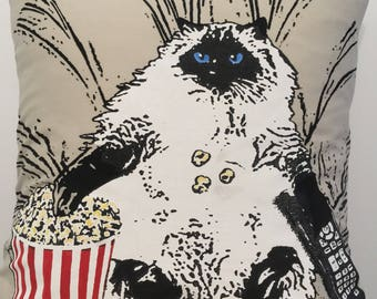 Cat watching movie pillow