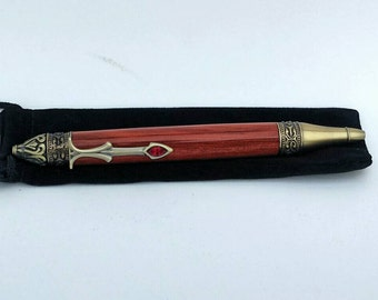 Gothika style pen trimmed in antique brass and turned from blood wood.