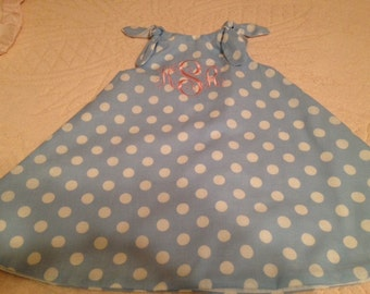 Infant and girls reversible swing dress with monogram.