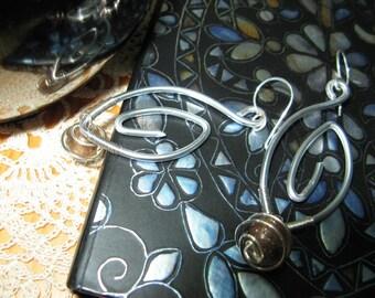 Fancy silver plated copper bullet earrings