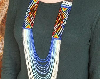 Columbian tribal beaded necklace, blue, light blue, white, multi color, with some sparkle & black