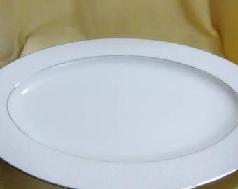 Vintage South Hampton platter. # 384. White with silver trim. White paisley design around outer edge.