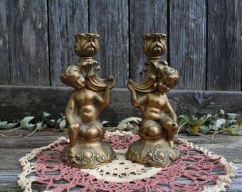 Pair of Hollywood Regency Style Cherub Candlestick Holders