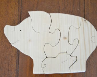Wood Puzzle 4 pieces of a sow and her piglet toy