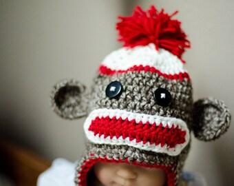 Sock monkey earflap hat