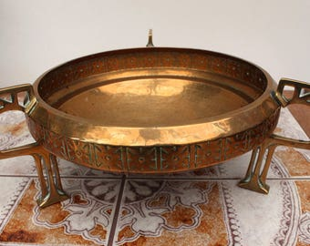 An Arts and Crafts Decorative Brass Bowl on Three Ornate Cut-Out Legs with Hammered Finish