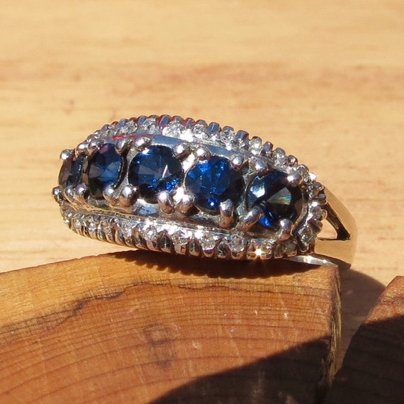 18K white gold ring with one Carat of round cut sapphires & 1/3 Carat diamonds.