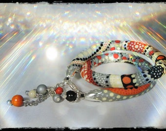 SOLD - 2 in 1 - wrap Bracelet or crew neck - the daughter of the STEPPES - multicolored fabric with dominant black, grey, orange