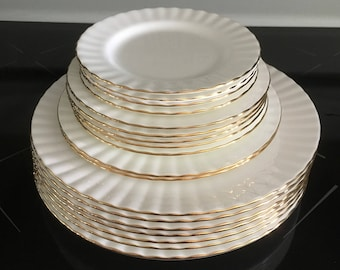 Royal Albert Val D'or Dinner plates Salad Plates Dessert Plates and Bread and Butter Plates.