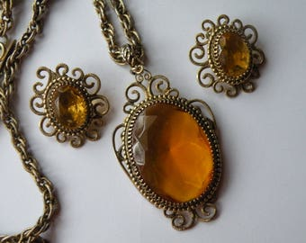 Whiting and Davis topaz glass pendant and clip-on earrings. Demi parure. Set.