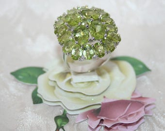 Pretty Ring set with genuine Peridots in Solid Silver 925