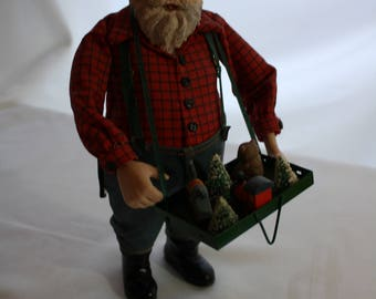 Santa in Work Clothes Dungarees and Suspenders, Toys in a Tray, 11 inches Tall, Left Hand needs Glue