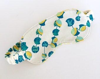 Reversible Sleep Mask: Teal newspaper text dots with yellow polkadot backing