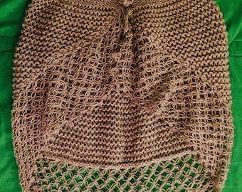 Crocheted Lacy Wrap With Flower Button