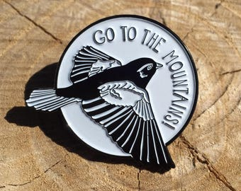 Go to the Mountains - enamel pin made from hand-drawing by Sara Schalliol-Hodge