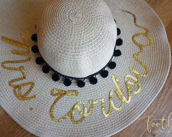 Customized Newlywed Mrs Women's Floppy Tan Beige Floppy Straw Sun Beach Hat with black sequins and black Pom Pom trim