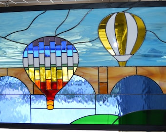 Stained glass balloons over London Bridge