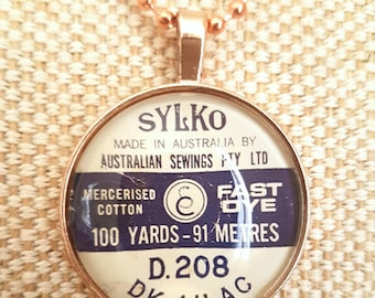 Rose gold vintage cotton spool pendant / upcycled sylko label necklace / sewing gift / includes chain / glass cabochon necklace