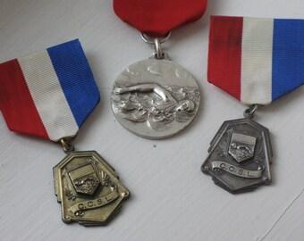 vintage swim medal with ribbon