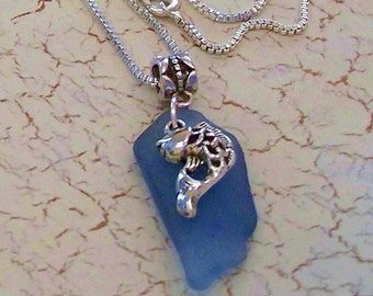 Natural Blue Sea Glass Pendant with a Pewter Fish Charm by Carol Wilson of Jet'adorn