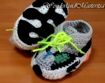 Baby booties. Clothing for children. Handmade. Knitted booties.