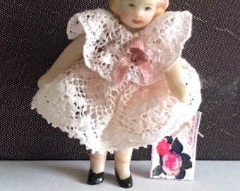 "Darling Little 1 1/2"" Bisque Doll"