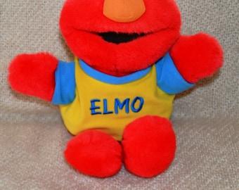 "THAT TICKLES "" & "" Oh Boy."" Elmo talks, 16 1/2"" Tall. Vintage "" 1995."" Yellow and Blue Elmo Shirt. Red Plush."