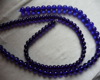 2 Strands of Glass Beads, Shades of Royal Blue. Sold per 16 inch strands. The strands are 8mm and 10mm round beads.
